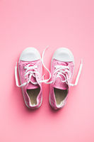 Retro sneakers. Tennis shoes on pink background. Top view.