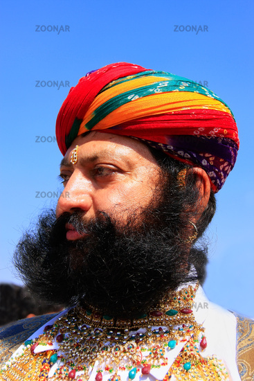 Portrait of indian man taking part in Mr Desert co