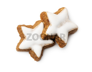 Icing gingerbread stars. Traditional Christmas cookies.