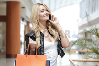 Shopping woman talking on the phone
