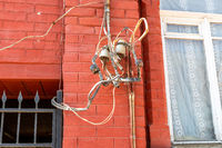 Electrical equipment and high voltage wiring lines on the wall
