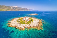 Aerial view of lonely island with lighthouse, island Vela Sestrica