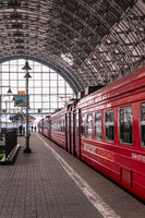 Moscow, Russia - March 23, 2013: Covered platform of Kievsky railway station. Red train aeroexpress to airport. People on the platform beside the Aero express train at Kievsky railway station Moscow