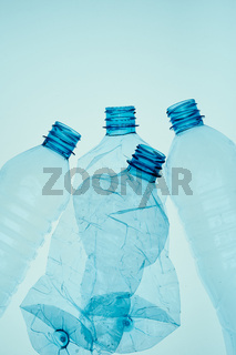 Empty plastic squashed bottles collected to recycling