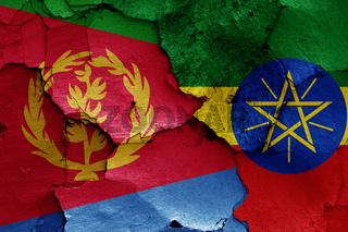flags of Eritrea and Ethiopia painted on cracked wall