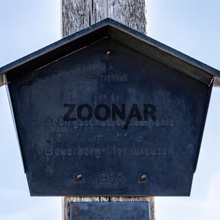 Summit Cross Sign of Jochberg, 1565 m in Winter. Located in Bavarian Prealps near Kochel am See, Upper Bavaria, Germany