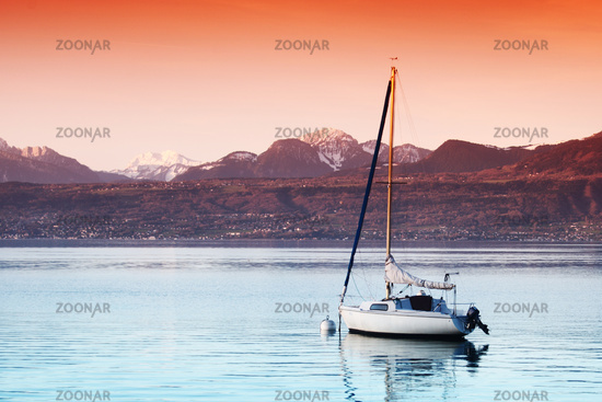 yacht in lake of geneva landscape on sunrise