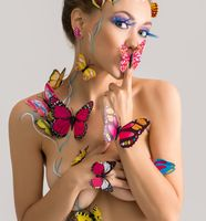 Bodyart. Pretty nude girl posing with butterflies