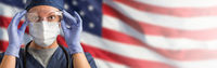 Doctor or Nurse Wearing Medical Personal Protective Equipment (PPE) Against The American Flag Banner
