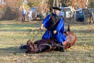 Hungarian csikos horseman in traditional folk costume