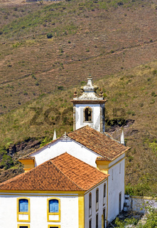 View from behind of old and historic church in colonial architecture from the 18th century at Ouro Preto city