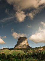 Devil's Tower in Wyoming during the day with dramatic clouds