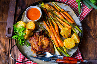 grilled neck chops with caramelized vegetables.