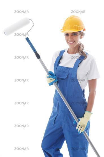 Female house painter on white