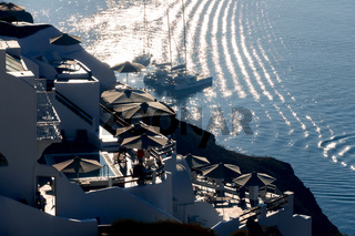Backlit Houses on Santorini Caldera and Parked Yachts