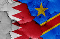 flags of Bahrain and Democratic Republic of Congo painted on cracked wall