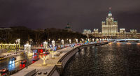 Moscow, Russia - February 04, 2020: View of the night winter Moscow with the Moscow river and high-rise building on Kotelnicheskaya embankment. Russia