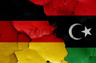 flags of Germany and Libya painted on cracked wall