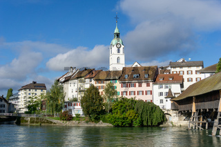 view of the Aare river and the historic old town of Olten and wooden bridge