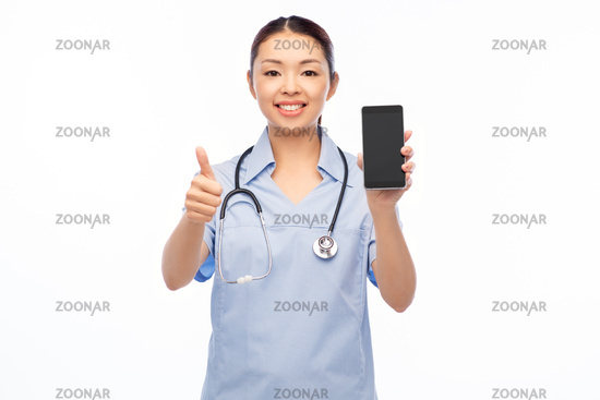asian female nurse with smartphone shows thumbs up