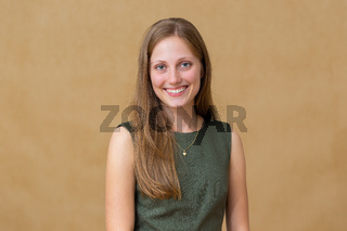 Young blonde woman smiling to the camera in studio