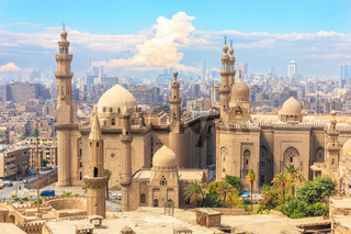 The Mosque-Madrassa of Sultan Hassan and Cairo buildings in the background, Egypt