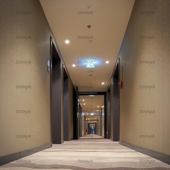 empty corridor with room doors in a hotel