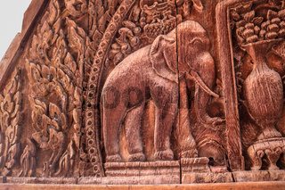 Elephant depiction. Piece of wood curving artwork