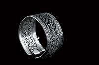 silver bracelet on black background