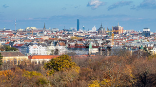 Urban landscape with roofs of historic and modern buildings in Vienna.