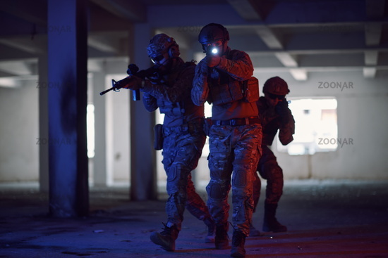 Soldiers squad  in tactical formation  having action urban environment