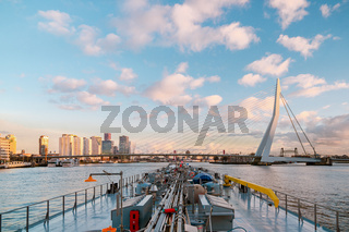 Binnenvaart, Translation Inlandshipping on the river Nieuwe Maas Rotterdam Netherlands during sunset hours, Gas tanker vessel Rotterdam oil and gas transport