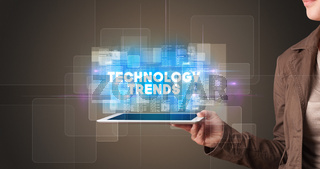 Person holding tablet, technology concept