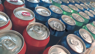 Rows of colorful metal cans with soda drink in shop