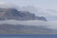 Fog over mountains of Djúpivogur, Iceland