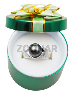 decorated green box with black pearl in gold ring