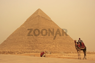 Bedouin on a camel near Pyramid of Khafre in a sand strom, Cairo