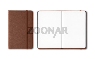 Dark leather closed and open notebooks isolated on white