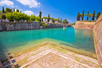 Peschiera del Garda turquoise channel around town walls view,