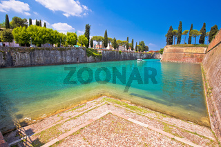 Peschiera del Garda turquoise channel around town walls view,