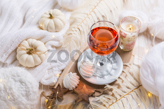 Cosy still life for winter and autumn with glass of pink wine
