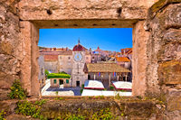 UNESCO Town of Trogir main square viewthrough stone window