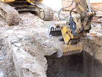 Excavator bucket when demolishing a cellar