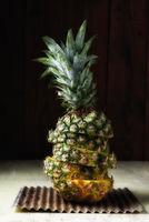Sliced pineapple put back together with slices offset.
