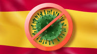 Warning sign with crossed out Coronavirus molecule on the background of Spanish flag.