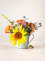 Colorful flowers in metall pot
