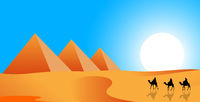 Camel riders on a background of pyramids