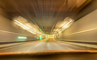 Fast drive with a car through a underground tunnel - street view.
