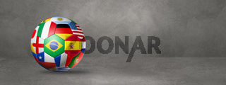 Football soccer ball with national flags on a concrete studio banner