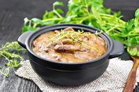 Goulash of beef in pan on board